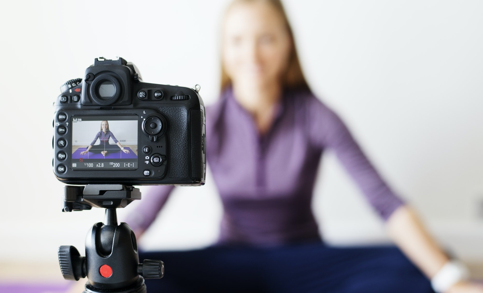 Female vlogger recording sports related broadcast at home